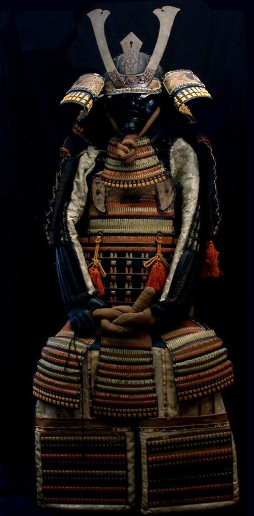 "Samurai Armor, not made of metal but of leather ""shingles"" and padding that create protection"