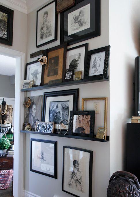 photo ledges with hung photos - dark frames