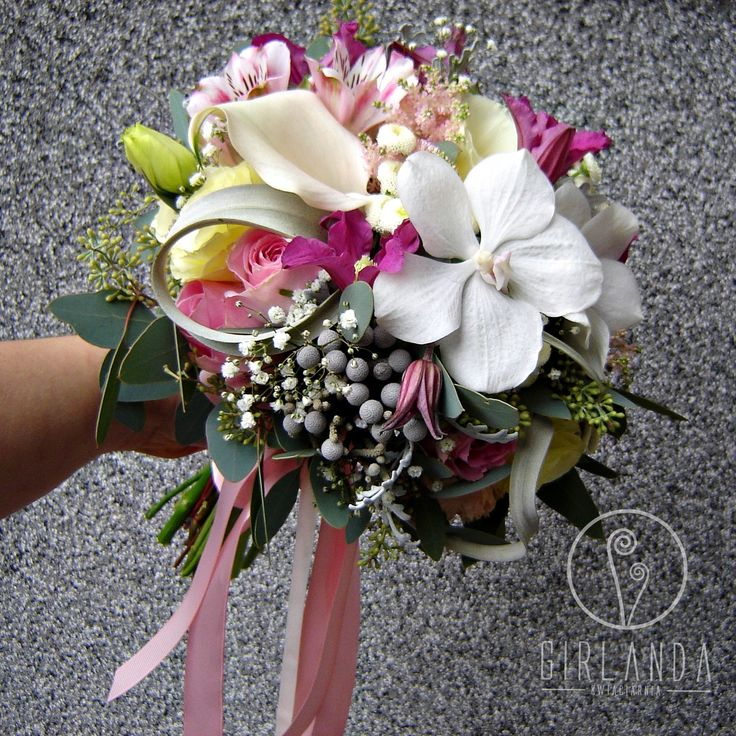Wedding bouquet with Vanda Orchid, Clematis, Tilandsia, Brunia, Zantedeschia.  The bridal bouquet is in white, pink, grey colors. To made it we used an eucalyptus. By Kwiaciarnia Girlanda Białystok.