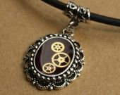 Small Silver Steampunk Frame Pendant containing Watch Gears on Black Neoprene Necklace