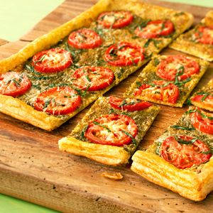 This sophisticated spin on pizza can be served at any occasion.  The fresh tomatoes, basil and Parmesan cheese are enlivened by a tender and delicious puff pastry crust.