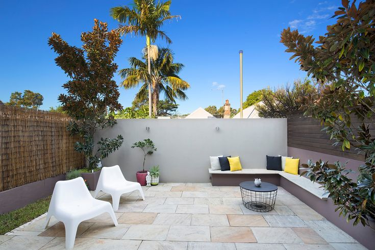 Immaculate home, spacious designer interiors, sunny garden courtyard, outdoor seating, cushions, coffee table, Pilcher Residential