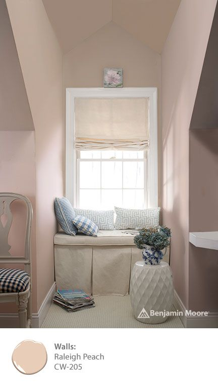 Make your favorite reading nook cozy and relaxing with beautiful, nuanced colors that are historic and totally modern from the Benjamin Moore WILLIAMSBURG Collection. This room features 'Raleigh Peach CW-205' on the walls.