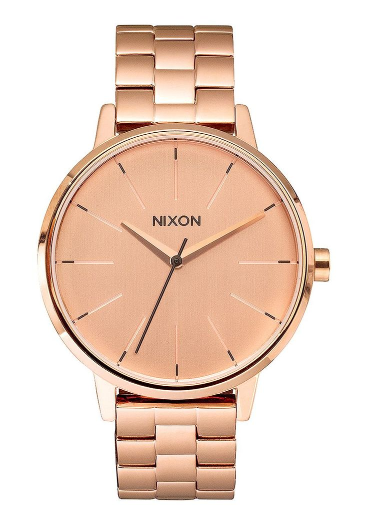 A perfectly round face sits connected by a thin band on the Nixon Women's Kensington Watch; whose delicate design has a look that's striking for a night out on the town. The stainless steel case with