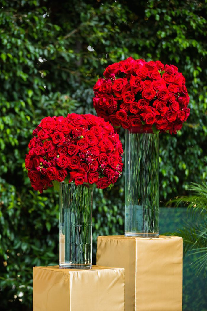 Red Rose Arrangements on Gold Pedestals | Photo: Lin & Jirsa Photography.