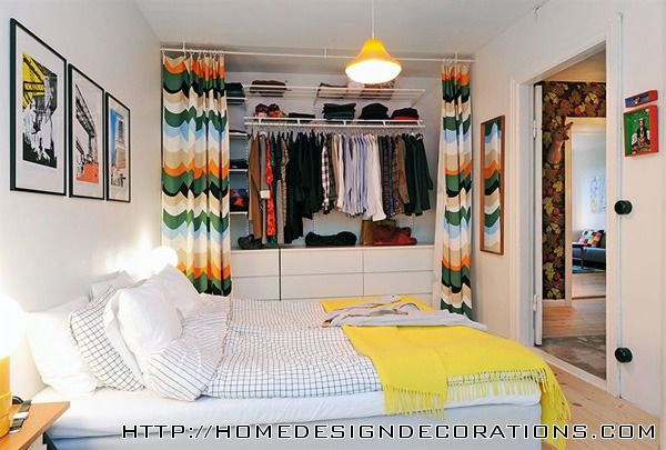 why not open up the master closet, add shelving and drawers, then hide it all with floor to ceiling curtains?
