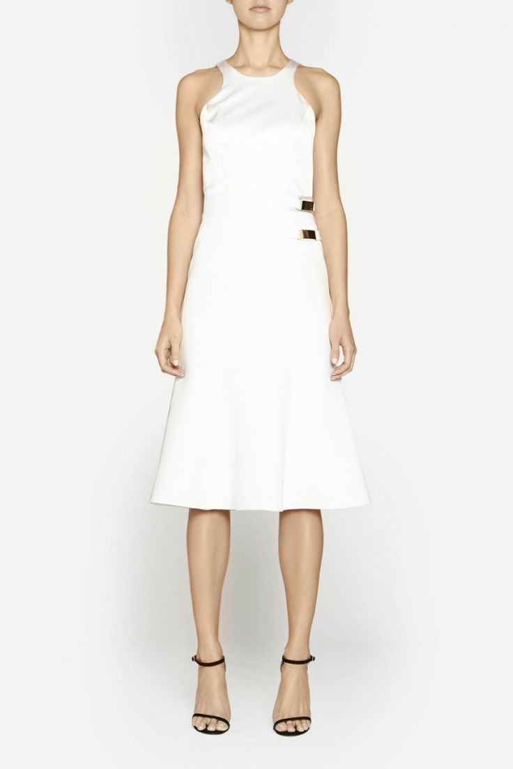 Camilla and Marc | EMPHATIC DRESS  US$630.45 Elegant cocktail dress with a fitted silk bodice and mid-length full skirt made a premium poly fabric. This piece features a racer-shaped front and back, fitted waistband, two gold side buckles, plus a full multi-panelled skirt. Fully lined and includes a invisible zipper at the centre back.