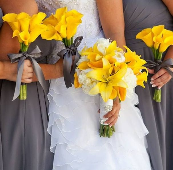 yellow flowers with grey bridesmaids dresses, that perfect pop of color down the isle