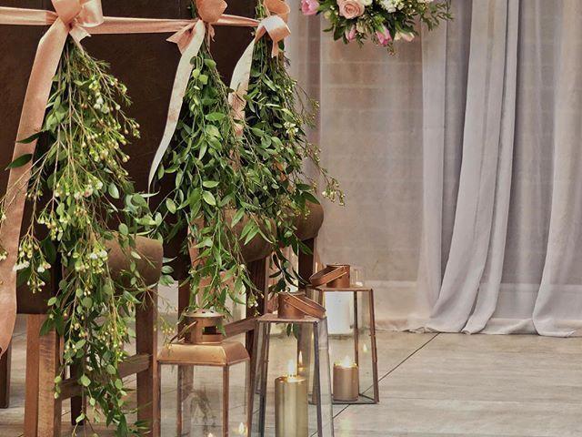 A simple and stylish combo for your aisle decoration... Ruscus & Wax Flower Pew ends tied with Rose Gold ribbon and Copper Lanterns with gold church candles lots of tints tones and textures   #wedding #bride #weddinginspo #weddingideas #weddingphotography #engaged #wedspiration #weddingdecor #couplegoals #weddingdress #lovestory #BrideToBe #flowers #soloverly #weddingFlowers #loveFlowers #inspiration #instagood #derbyshire #picoftheday #weddingplanning #avantgarden #realWedding #weddinghour