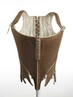 CF. Stays. 1780-1795. Corset of brown cotton twill with shoulder straps that tie at front with cotton (linen?) twill tape; holes down centre back for closure.