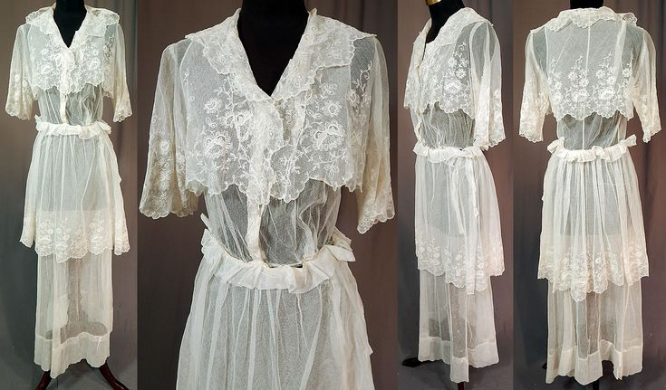 Titanic Edwardian Embroidered White Tulle Net Lace Crop Top Dress Tea Gown  This vintage Titanic Edwardian era embroidered white tulle net lace crop top dress tea gown dates from 1912. It is made of a sheer white tulle net fabric, with white embroidery work done in floral vine leaf designs and Rose Point de Gaze style lace.