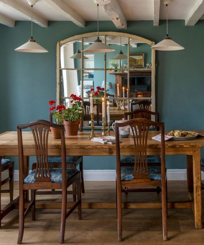 Country Kitchen Décor Teal Wall With Large Mirror Near Wooden Dining Table With Four Retro Chairs Wooden Dining Room Teal Boho Dining Room Dining Room Colors