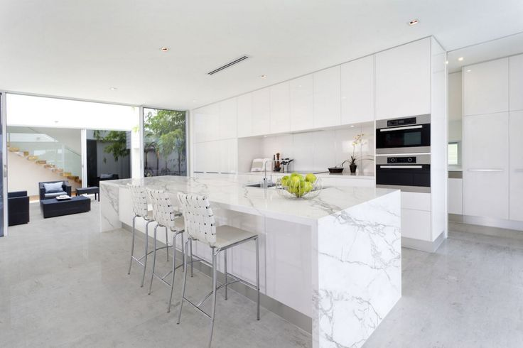 Bright and clean are exactly what a kitchen should be. Marble countertops by Omicron Granite & Tile certainly help.