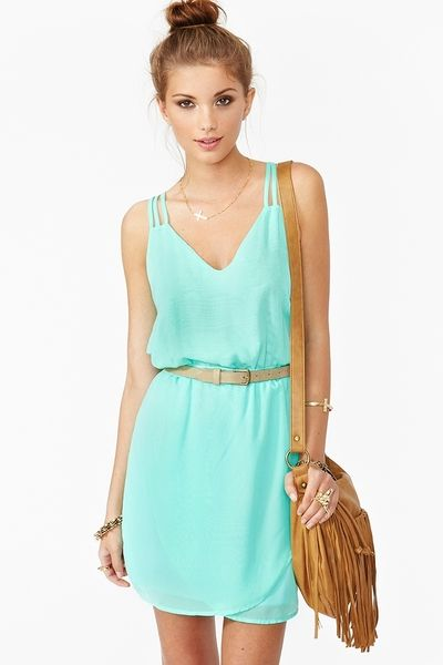 bun, mint dress, purse