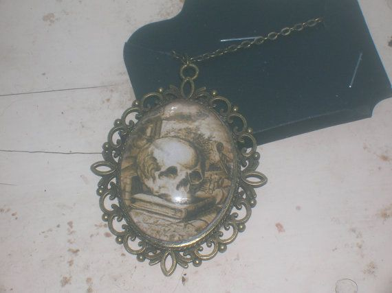 victorian gothic skull and book pendant