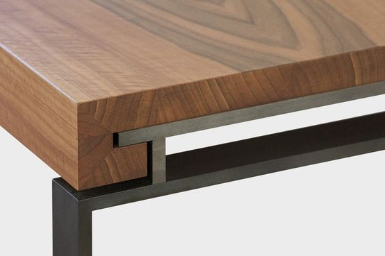 The solid wood top has mitered corners. Love how it returns into the metal base.