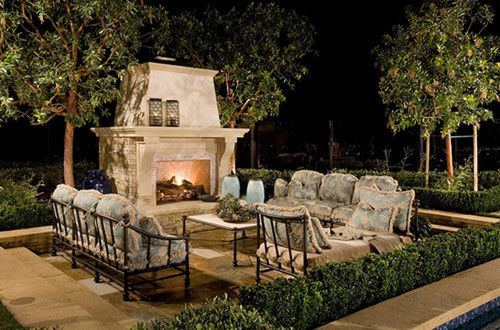 Landscape ideas for backyard mediterranean backyard for Mediterranean fireplace designs