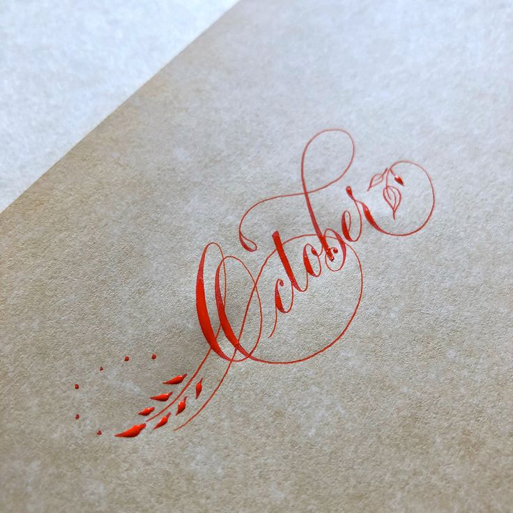 Video of Suzanne Cunningham creating this flourished version of October with vermilion sumi ink.
