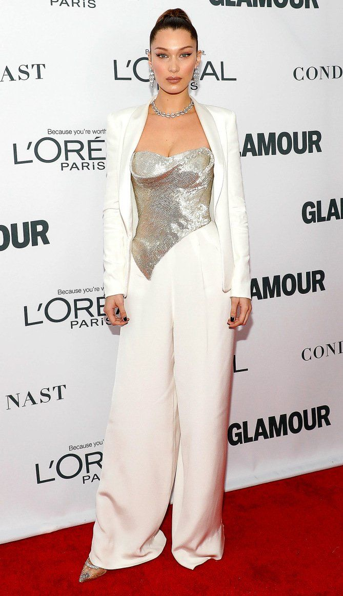 Bella Hadid in a white and silver jumpsuit and jacket