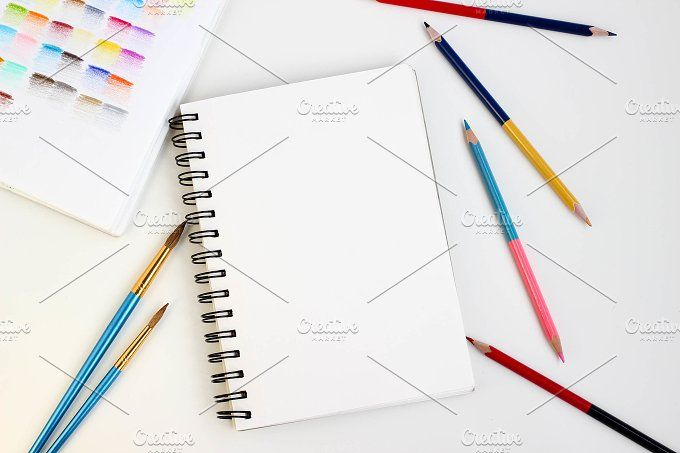 Art supplies on white table,top view by Irina on @creativemarket