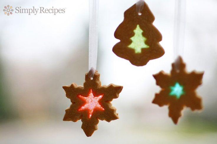 Stained Glass Cookies ~ Beautiful, festive stained glass cookies.  Sugar cookies cut out and filled with hard candy to look like stained glass windows when they are baked. ~ SimplyRecipes.com