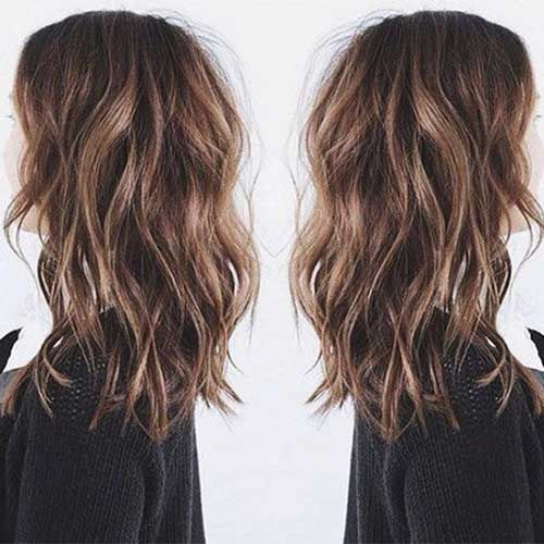 Shoulder length with beach waves                                                                                                                                                                                 More