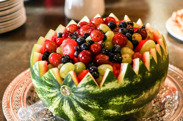 Watermelon Bowl Fruit Salad - A simple and elegant fruit salad made in a watermelon bowl. These are great for parties where you will be serving many people.