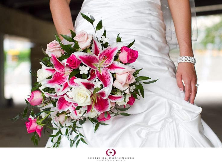 Hot pink and white cascade bouquet featuring Stargazer lilies, roses, and stephanotis.
