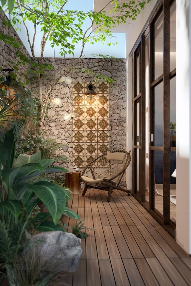 Stone And Tile Feature Wall Creates An Earthy Backdrop And N This Outdoor Area Small Backyard Garden Design Backyard Garden Design Small Courtyard Gardens