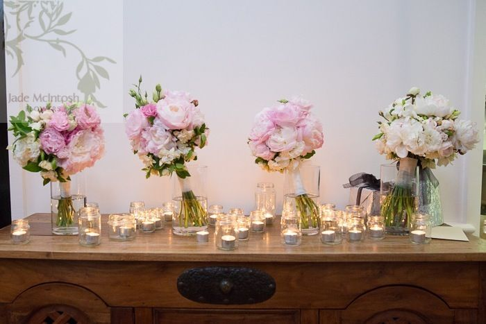 Roughly rounded, soft natural stem bouquets of open blowsy peonies, fragrant gardenia, david austen roses and lisianthus in shades of white, blush and pink www.jademcintoshflowers.com.au www.wandinvalley.com.au/weddings
