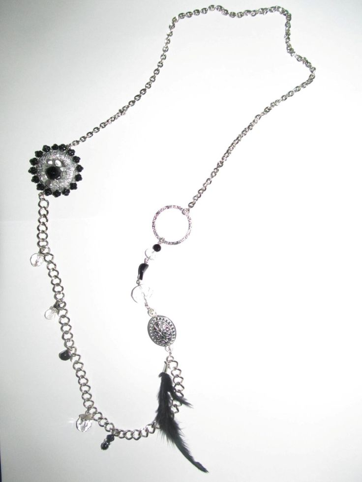 Handmade necklace (1 pc)  Made with silver color chains, glass beads and handmade motif with wire and glass beads.
