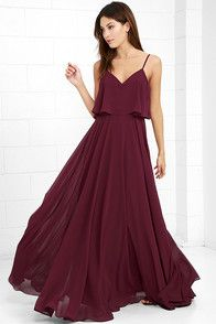 We're absolutely love struck over the Love Runs High Burgundy Maxi Dress! Burgundy woven poly falls from adjustable straps into a tiered, triangle bodice above a cascading maxi skirt full of volume. Hidden side zipper.