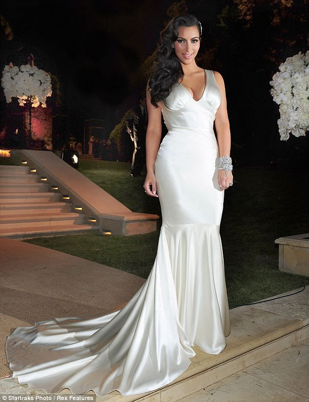 Style queen: Kim strikes a pose in her third dress of the day