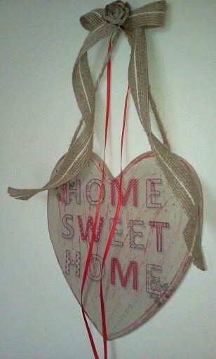 Decoupage on wooden heart.