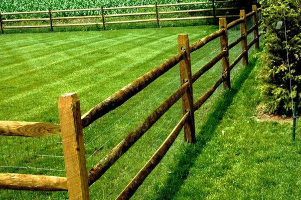 Wooden Split Rail Fence with wire for the dogs - way better than chain link and won't obscure our view like a solid fence!