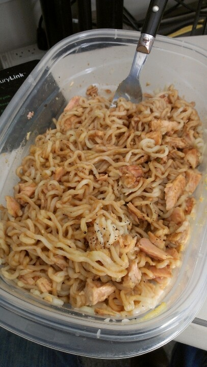 Lunch at work under a dollar... Roman noodles, tuna, season, soy sauce... Cook and drain noodles, drain tuna, mix together with seasons