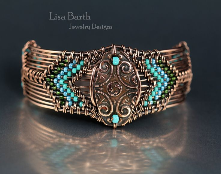 Hand woven copper bracelet with a copper metal clay piece I made for the centerpiece. --Lisa Barth
