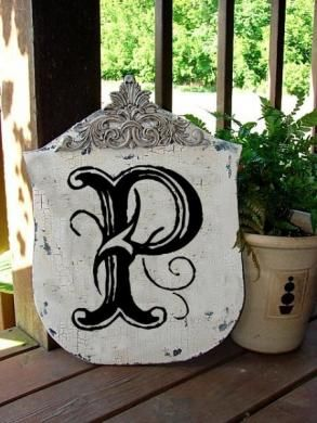 Pretty Letter i can make one plack out of a board or cement then paint & monogram it and put it in the yard