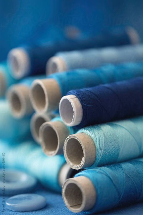 letterstomyinnerchild:  Stacked blue toned spools of threads By PavelGrAvailable to license exclusively at Stocksy
