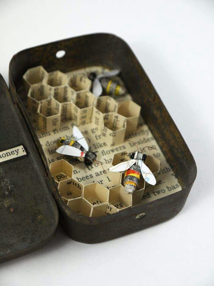 Kate Kato. Honey bees in their hive, made from recycled book pages, map and matchbox labels. www.kasasagidesign.com