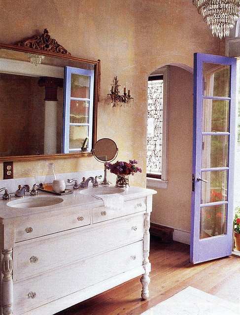 Something about the dresser/sink makes this bathroom feel cozy. Vintage looking.