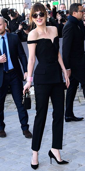 DAKOTA JOHNSON In her sexy Dior jumpsuit, glam Sunday Somewhere shades and that pretty smile, Dakota's a dead ringer for mom Melanie Griffith.