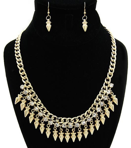 Arrow Gold and Crystal Chain Statement Necklace. Thick gold chain with a row of gold arrowheads connected to the chain by a row of crystals.
