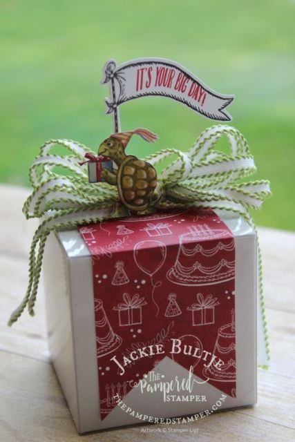 I added a cut out turtle from the designer series paper and then used the framelit and the stamp to make an adorable banner and affixed it to a toothpick. It is all attached to the heavy acetate sleeve around the box so it won't get destroyed when the gift is opened.