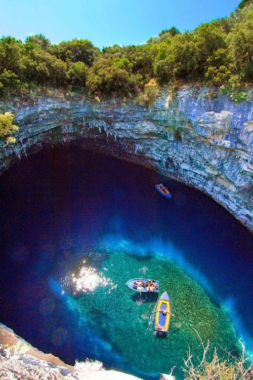 Melissani Cave, Kefalonia, Greece. This looks so fake, but would be nice to go.