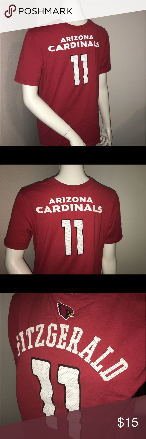 "Youth Larry Fitzgerald jersey style T-shirt sz: XL Thank you for viewing my listing, for sale is a youth/kids, NFL, Arizona Cardinals, Larry Fitzgerald, jersey style, short sleeve, T-shirt.  This is a T-shirt but The screen print looks like a jersey.  Sz: youth XL   If you have any questions or would like additional photos please feel free to ask.  From under one arm to under the other measures appx 19""from the top of the shoulder to the bottom of the shirt measures appx 25"" NFL Shirts…"