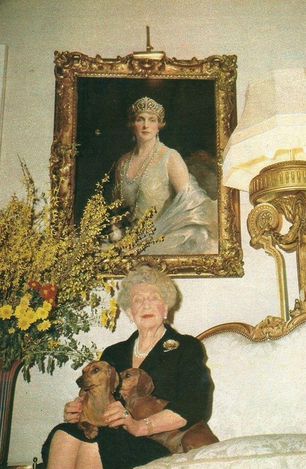 Ena sitting below her portrait
