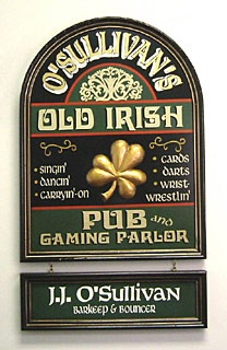 "Personalized Old Irish Pub and Gaming Parlor Plaque.  Our signs of the times have your name on them. Slightly distressed wood creates an antique look. Name plaque attaches to pub sign or hangs alone. Hardware included. Shipped separately; allow 3-4 weeks. USA. Personalized Old Irish Pub Plaque 18"" x 24"". Personalized Name Plaque 5 1/2"" X 18"". $99.00"