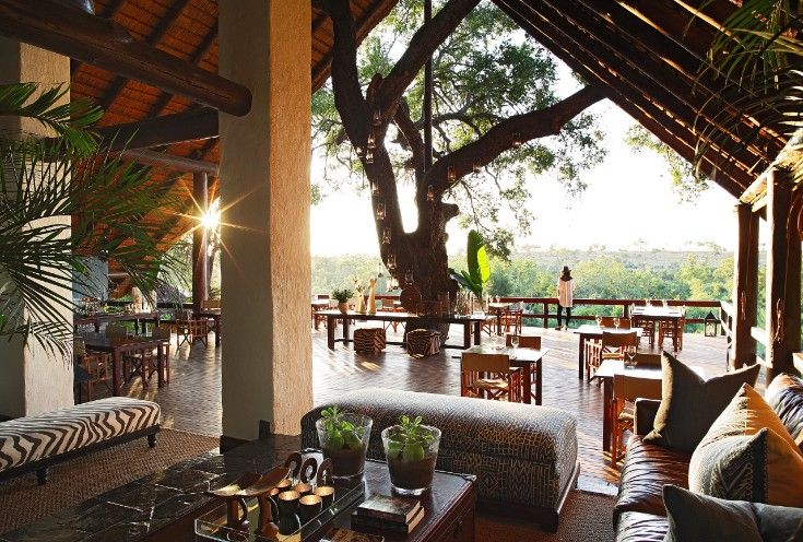 The perfect spot for a lazy afternoon cocktail, or a spot of tea before heading out on safari - The Varty Camp deck overlooks the Sand River