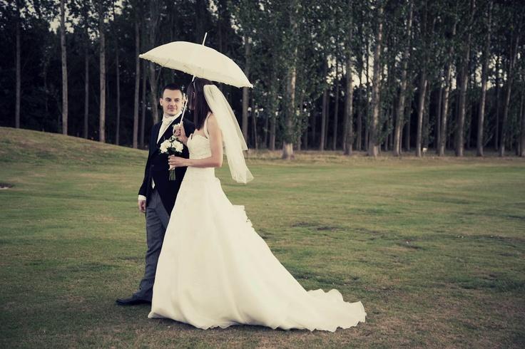 www.kerryannduffy.com  Kerry Ann Duffy Photography: Karen & Paul's Wedding - Bobbing Church & Weald of Kent, Headcorn.  bride and groom with umbrella